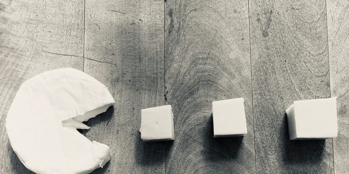 Camembert PacMan eating cheese blocks